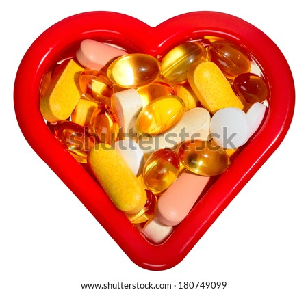 Nutritional supplements, pills and capsules for heart health. Isolated. - stock photo