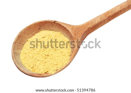 Nutritional yeast flakes in a wooden spoon isolated on white with clipping path included. - stock photo