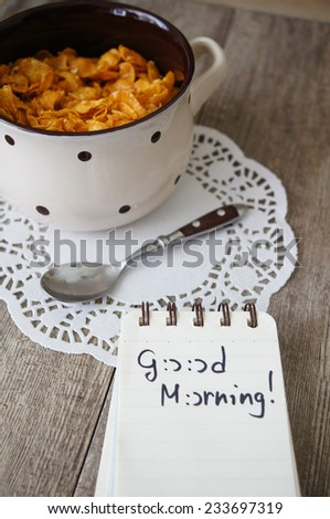 nutritious cereal cornflakes breakfast on the wooden table with honey and milk - stock photo