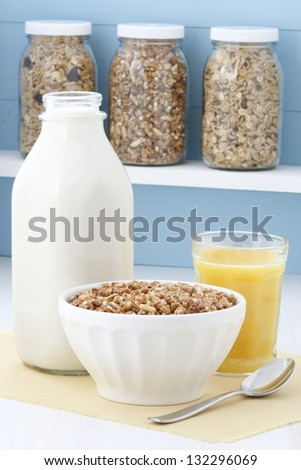 Nutritious cereal, high in bran, high in fiber, served in a beautiful  with wide rims. In place of handles. This healthy bran cereal will be an aid to digestive health. - stock photo