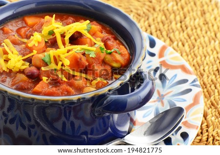 Nutritious vegetarian chili full of tomato, beans, peppers, sweet potato and corn - stock photo