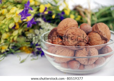 Nuts and a herbal bouquet - stock photo