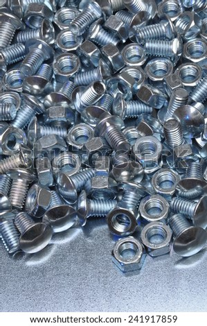 Nuts and bolts as industrial background  - stock photo