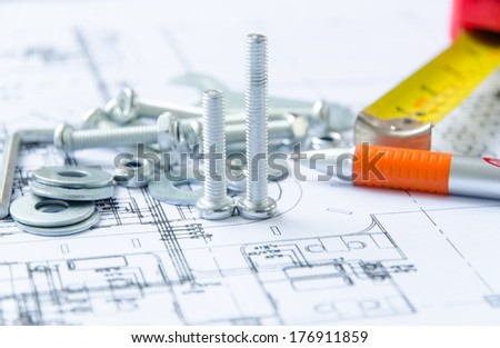 Nuts and bolts close-up over  architectural plan - stock photo
