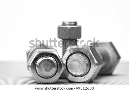 Nuts and bolts close up with shallow Dof - stock photo
