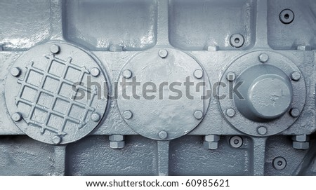 Nuts and bolts on  machine plate  background - stock photo