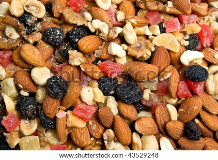 Nuts and dried fruits background - stock photo