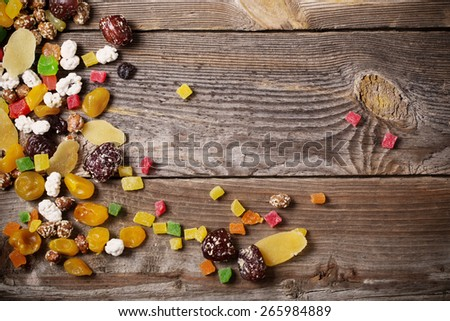 nuts and dried fruits mix on wooden background - stock photo