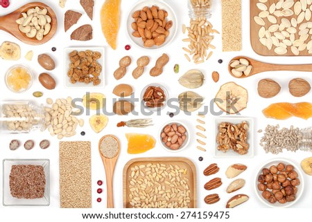 nuts and dried fruits on white background - stock photo