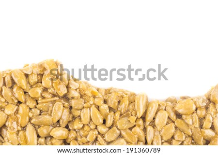 Nuts-and-honey bar, oriental sweets from candied sunflower seeds isolated on white - stock photo