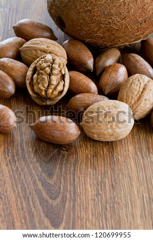 Nuts, assortment of  nuts on wooden background - stock photo