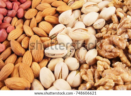 stock-photo-nuts-background-pistachios-a