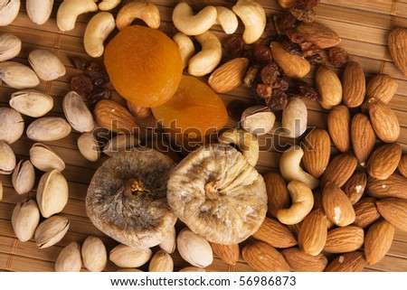 Nuts, fig and dried apricots still life