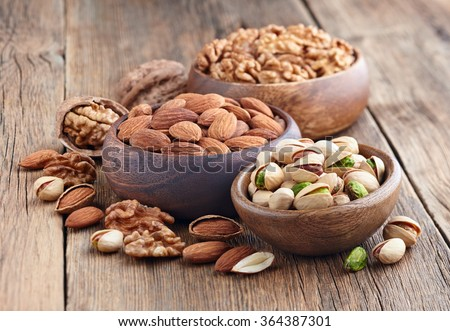 Nuts in a wooden background