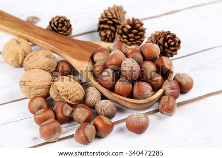 Nuts in a wooden spoon