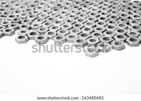 Nuts in an organized array pattern on white - stock photo