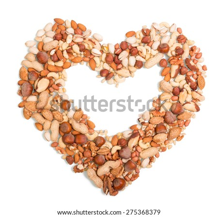 Nuts in the shape of heart isolated on a white background - stock photo
