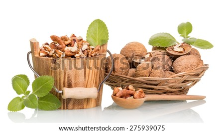 Nuts in wooden bucket and scoop isolated on white background - stock photo