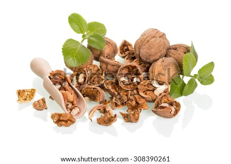 Nuts in wooden spoon and spoon isolated on white background - stock photo