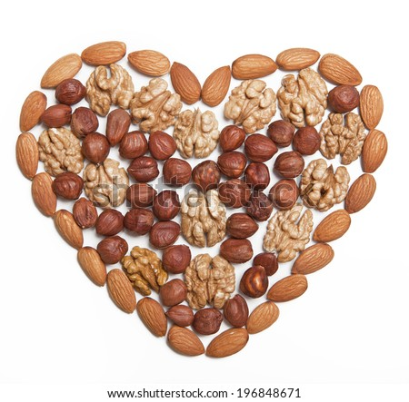 Nuts, laid out in the shape of a heart on a white background - stock photo