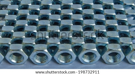nuts lined up in neat rows - stock photo