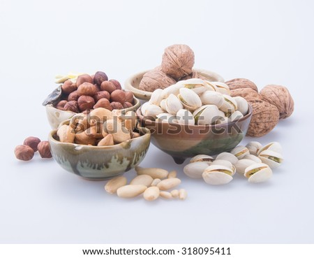 nuts. mixed nuts on background - stock photo