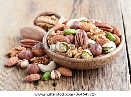 Nuts on a wooden background - stock photo