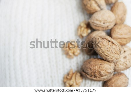 Nuts on white background. Hazelnuts and walnuts. Shabby nut background. Many nuts. Many hazelnuts. Hazelnut background.  - stock photo