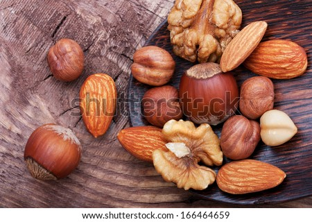 Nuts on wooden background.