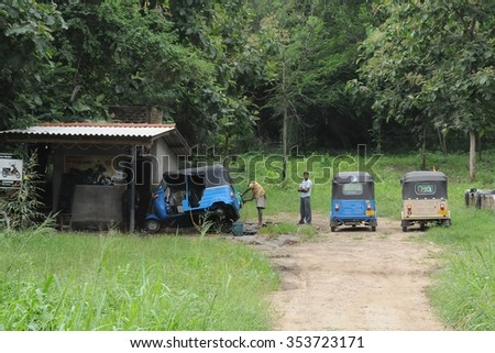 NUWARA ELIYA, SRI LANKA - DECEMBER 6, 2008:Workshop repair of tricycles on the outskirts of the city.