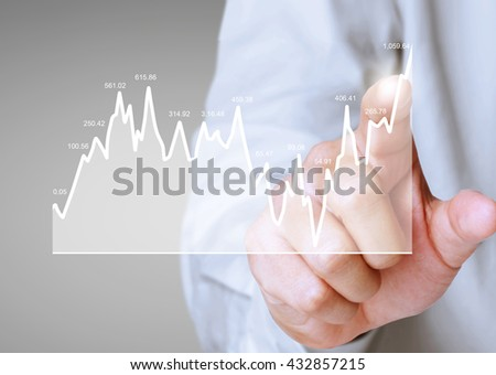 nvestment concept with financial chart symbols coming from a hand
