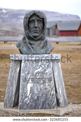 NY ALESUND, SVALBARD, NORWAY - JULY 14, 2015 Statue of Roald Amundsen in Ny Alesund, Spitsbergen (Svalbard), Arctic, Norway  - stock photo