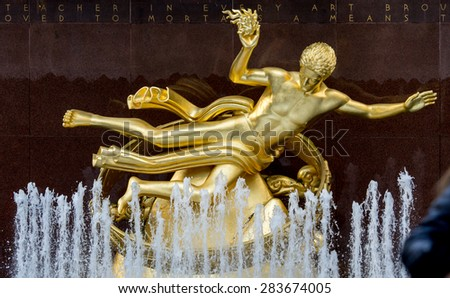NY - Manhattan 31 dec 2014: Statue symbol in front Rockefeller building in manhattan - stock photo