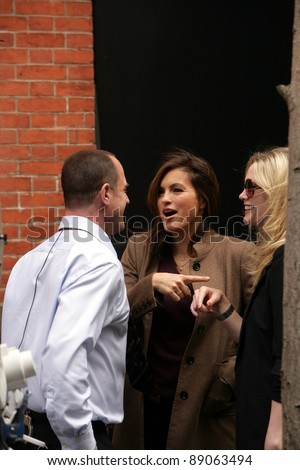 NYC - APRIL 15: Actress Mariska Hargitay, middle, with co-star Christopher Meloni, left, and former SVU star Stephanie March, right,  on the set of Law And Order: SVU in New York City on Friday, April 15, 2011.