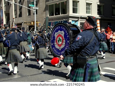 NYC - April 6, 2007:  Pipers marching up Sixth Avenue during the annual Scottish Tartan Day Parade - stock photo