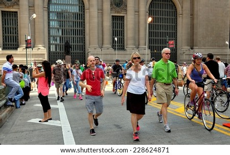 """NYC - August 16, 2013:  Bikers, joggers, and pedestrians on the Park Avenue overpass in front of Grand Central Terminal free of all traffic during the third """"Summer Streets"""" Saturday event - stock photo"""