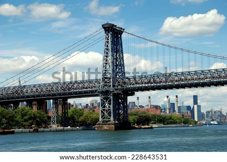 NYC - July 19, 2009:  The Williamsburg Bridge over the East River connects Manhattan to the Williamsburg district in Brooklyn