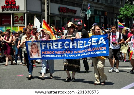 NYC - June 29, 2014:  Marchers with banner for Chelsea Manning, a Wikileaks whistleblower, marching at the 2014 Gay Pride Parade on Fifth Avenue - stock photo
