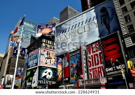 NYC - May 5, 5010:  Advertising covers the sides of buildings promoting Broadway musicals and films in Times Square at West 46th Street - stock photo