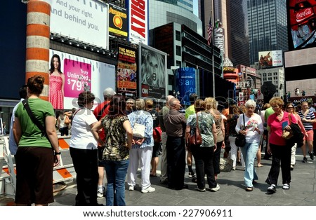 NYC - May 28, 2011:  Crowds queue in line at the TKTS booth in Times Square to buy discounted tickets for Broadway shows