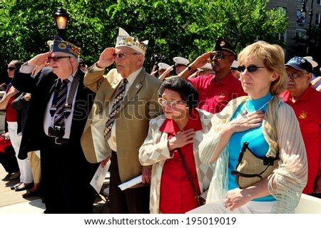 NYC - May 26, 2014:  Veterans and citizens stand at attention during the playing of the National Anthem at the Memorial Day holiday ceremonies in Riverside Park - stock photo