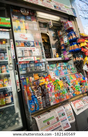 NYC, NEW YORK � CIRCA FEBRUARY 2014: A street vendor with various products and publications for sale. - stock photo