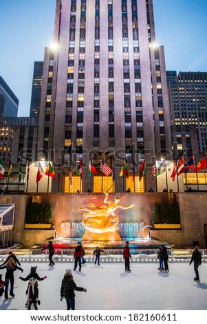 NYC, NEW YORK � CIRCA FEBRUARY 2014: People ice skate at night in front of the Rockefeller Center. - stock photo