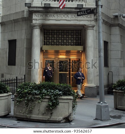 NYC - OCT 31: Two off-duty brokers stand by a back entrance to the New York Stock Exchange on Wall Street in New York City on Friday, October 31, 2008. - stock photo