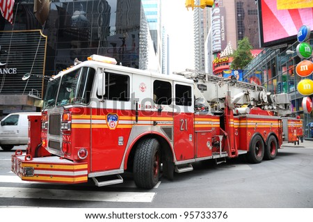NYC - OCTOBER 25: New York Fire Department Engine 24. The FDNY is the largest combined Fire and EMS provider in the world.October 25. 2010 in Manhattan, New York City. - stock photo