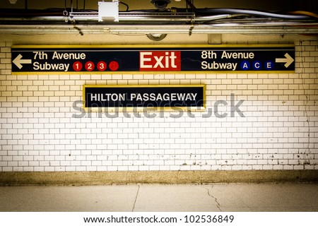 NYC Penn Station subway directional sign on tile wall - stock photo