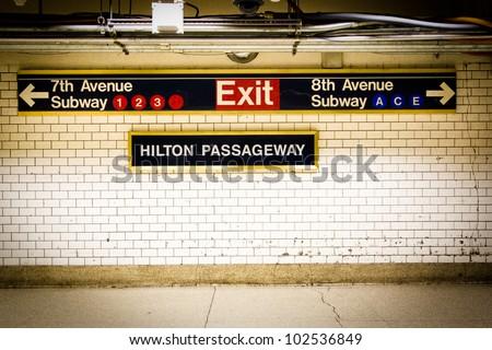 NYC Penn Station subway directional sign on tile wall