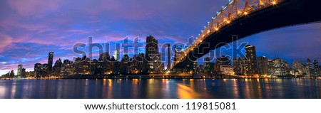 NYC Queensboro Bridge and Manhattan skyline panorama at dusk - stock photo