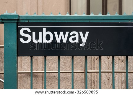 NYC subway entrance. The NYC Subway is one of the oldest and most extensive public transportation systems in the world, with 468 stations.  - stock photo