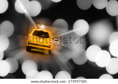 NYC yellow taxi with lights in tunnel - stock photo